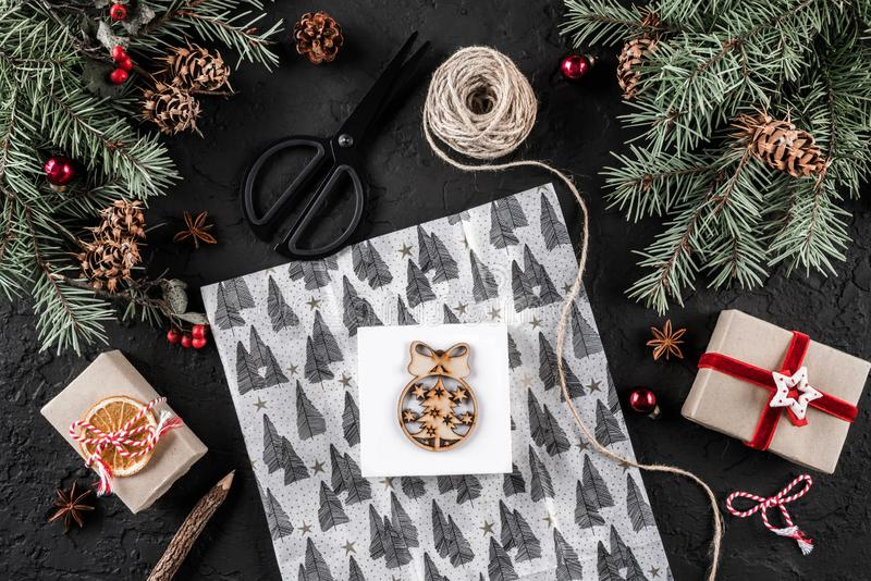 Christmas composition with letter, xmas wrapping, Fir branches, gifts, pine cones, red decorations, scissors on holiday background stock photos