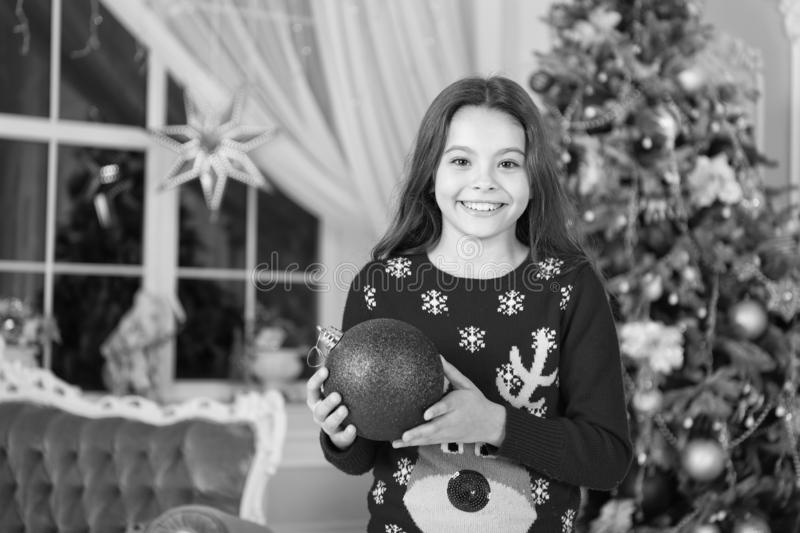 Christmas composition. little child girl likes xmas present. Happy new year. small happy girl at christmas. Christmas. Kid enjoy the holiday. The morning stock photography