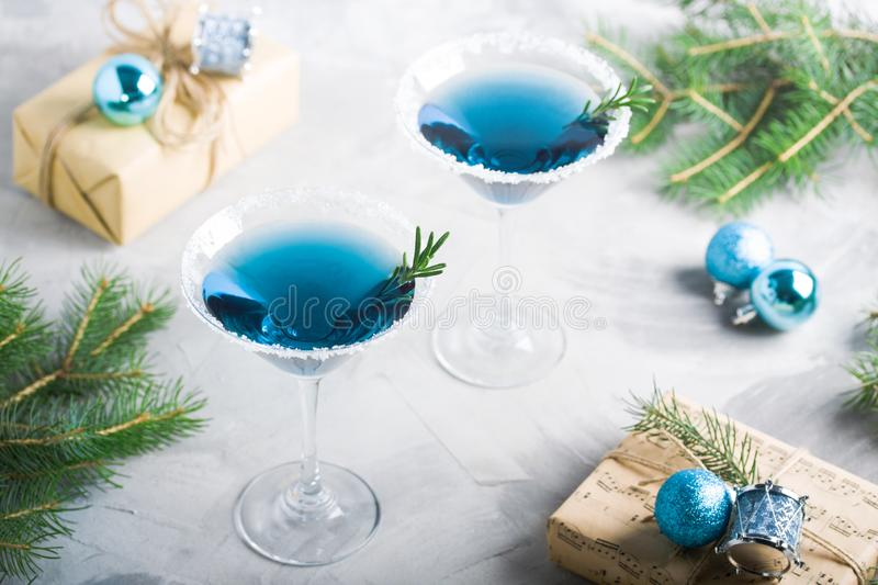 Christmas party composition with drinks gift boxes in blue color royalty free stock photos