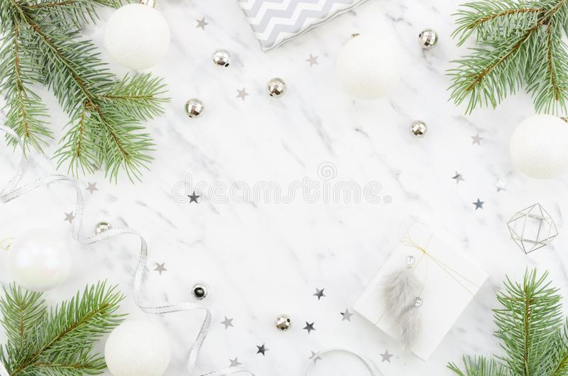 Christmas composition mockup with copy space. Flat lay fir branches, silver glass balls on marble background.  stock images