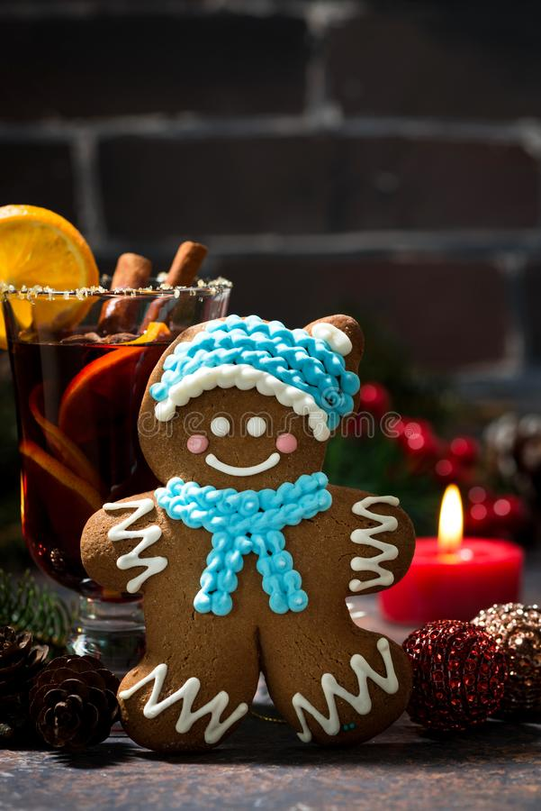 Christmas composition with mulled wine and gingerbread man. Closeup stock photography