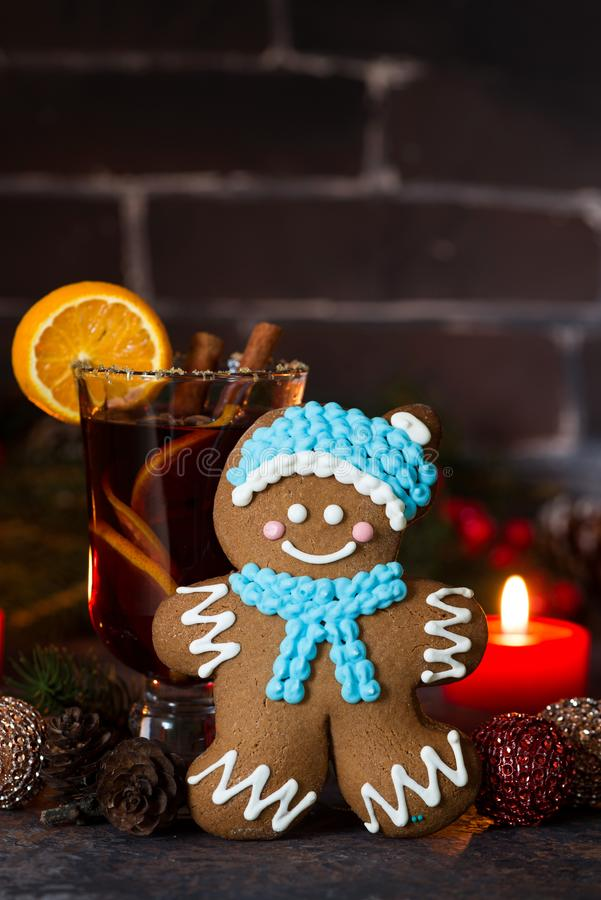 Christmas composition with mulled wine and gingerbread man. On dark background, closeup stock photos