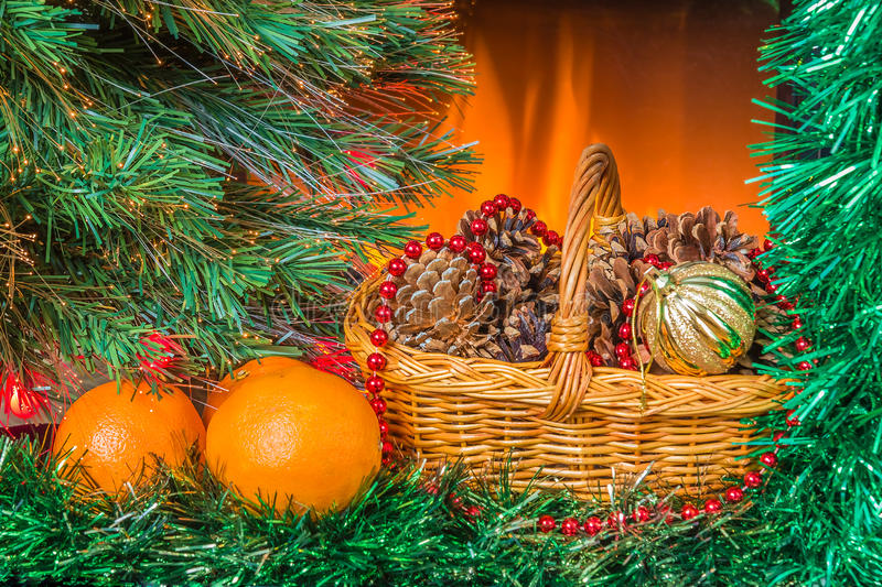 Christmas composition with oranges and basket. New year composition with oranges and basket near the fireplace stock photography
