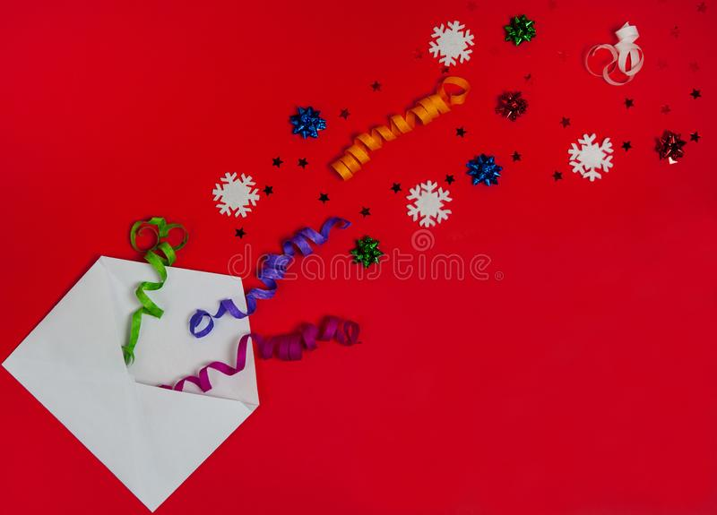 The pattern is made of envelope, serpentine, white snowflakes and shiny stars on a red background. Christmas, winter, New year. royalty free stock photos