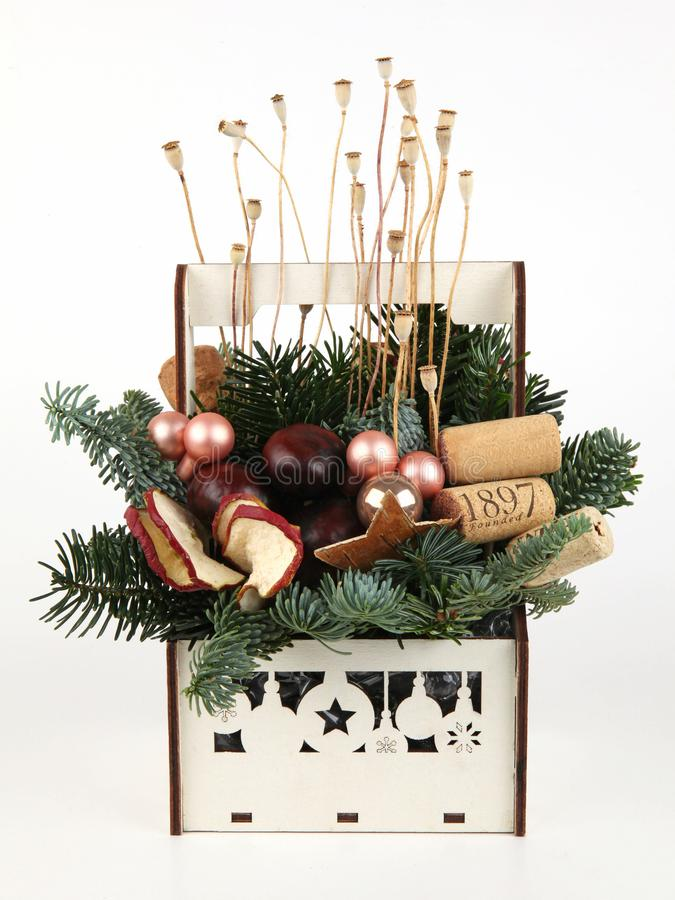 Christmas composition of pine branches, wine corks, balls, apple slices, poppy and chestnuts royalty free stock photo