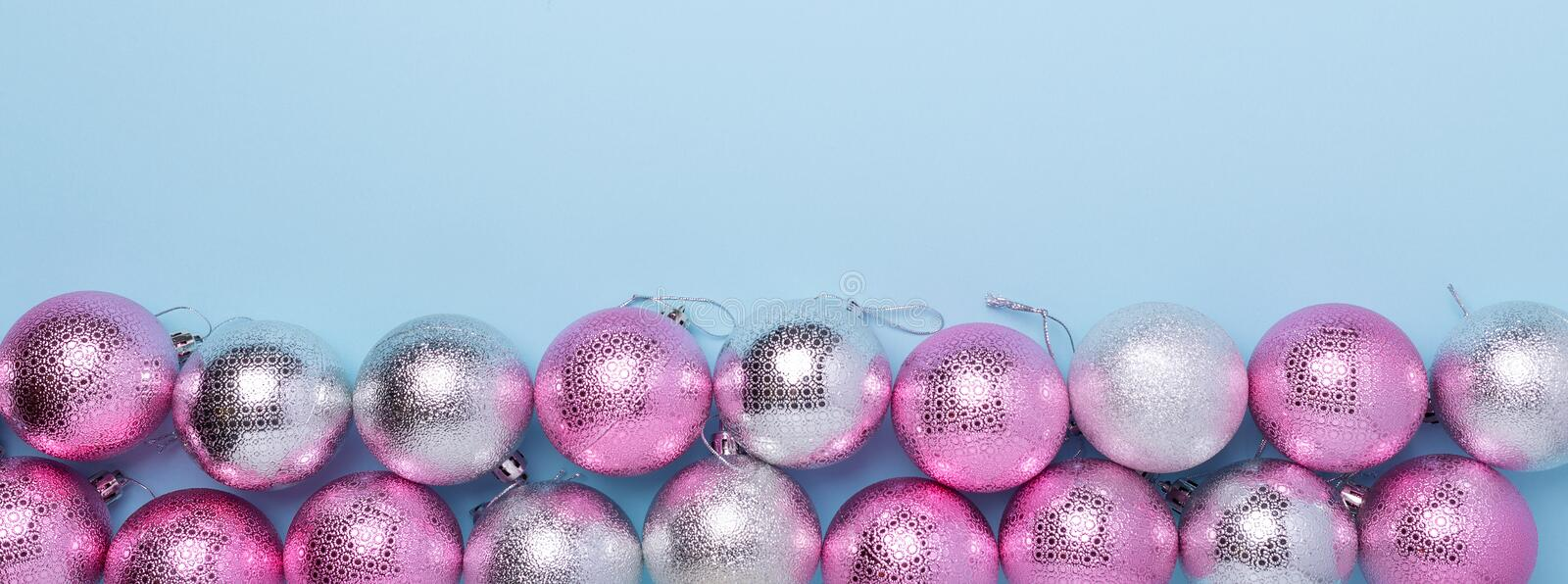 Christmas composition Pink and silver balls on pastel blue background. Web banner. Christmas, winter, new year concept stock photo