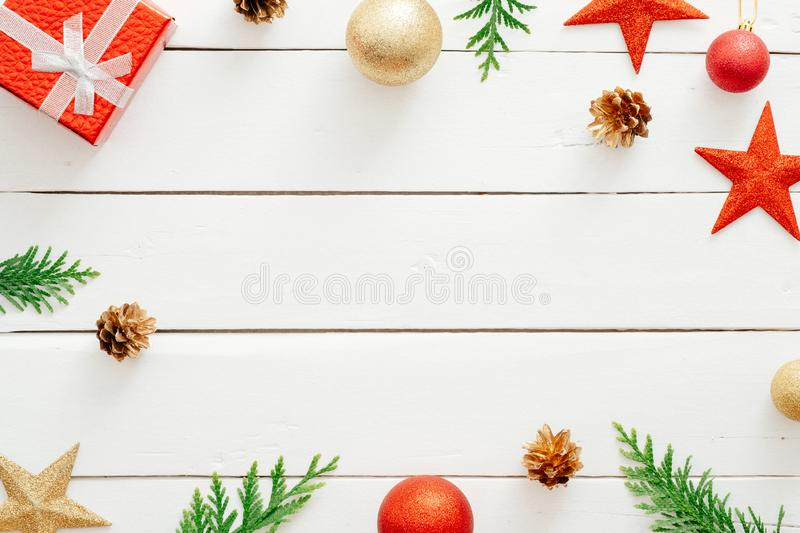 Christmas composition. Red gifts, decorations, fir tree branches, pine cones on wooden white background. Christmas, winter holiday stock photo