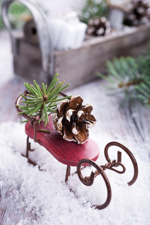 Christmas composition with sleigh, pinecone and decoration. On snow. Christmas greeting card royalty free stock photos