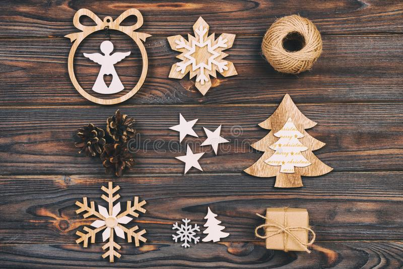 Christmas composition. Christmas snowflakes, Christmas tree and angel in a frame on a wooden background. New Year wooden vintage d. Ecorations stock photos