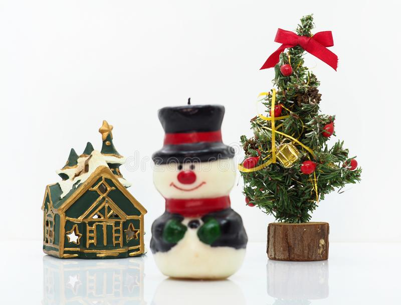 Christmas composition,snowman and a small christmas tree royalty free stock images