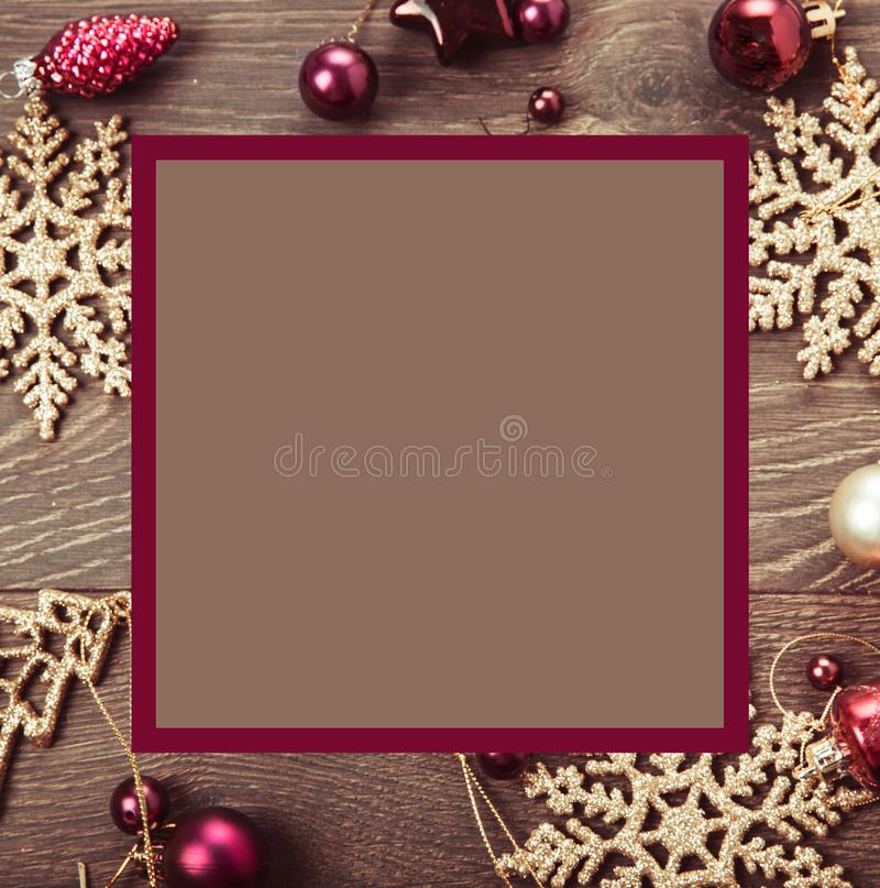 Christmas composition. Spruce branches, xmas tree, xmas pink decor holiday ball with ribbon on white background. royalty free stock photo