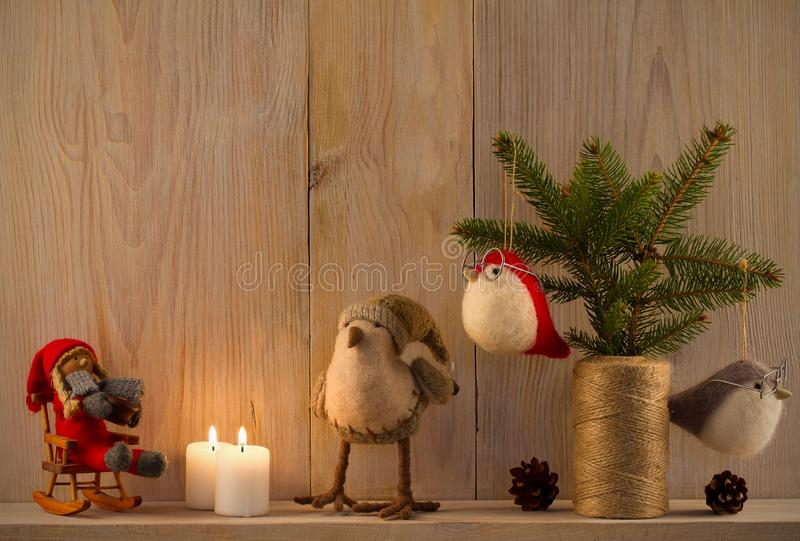 Christmas composition. Sweet home. Christmas decor on vintage natural wooden background. Cinnamon sticks, cookies and toys on shelf. Space for text stock photos