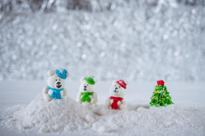 Christmas Composition. Three sugar candy bears playing in the snow royalty free stock photo