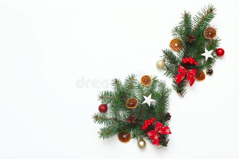 Christmas composition with Christmas tree branches and Christmas decorations on white background stock images