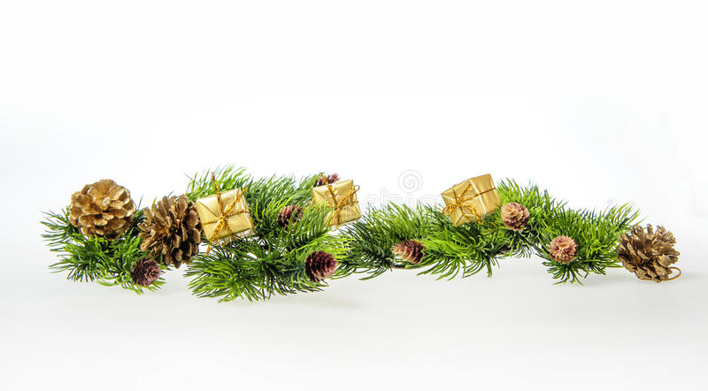 Christmas composition of tree branches and gifts stock photography