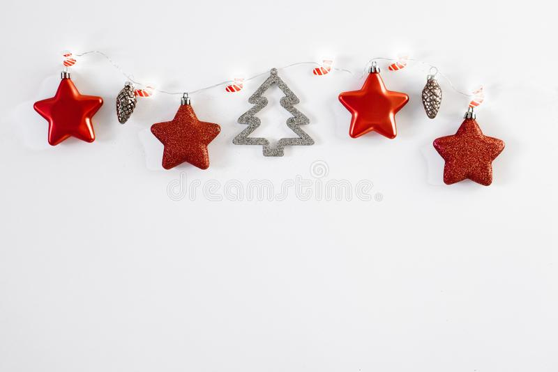 Christmas composition. Christmas tree ornaments, decorative reindeer, a fir branch and gold beads on a white background. Flat lay,. Christmas composition royalty free stock images