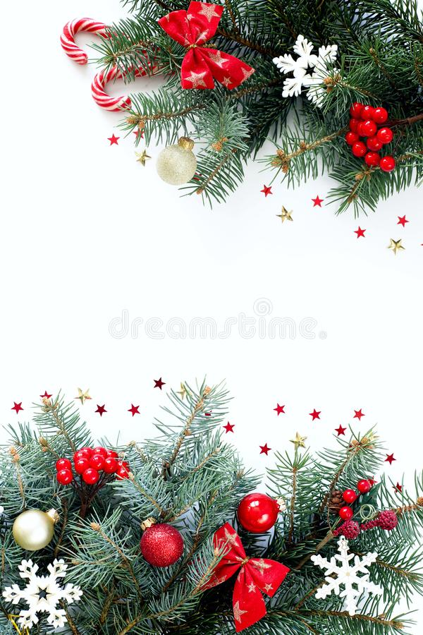 Christmas composition on a white background with Christmas tree branches. stock photo