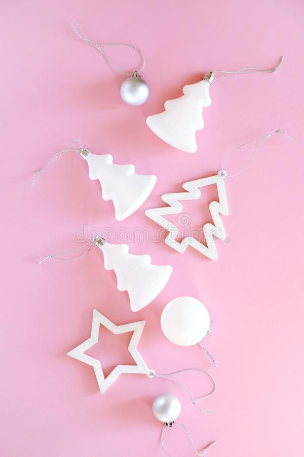 Christmas composition of white and silver decorations on a pastel pink background. stock image