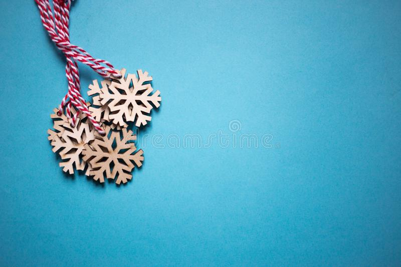 Christmas composition. Christmas wooden snowflakes decorations on blue background. top view, copy space royalty free stock image