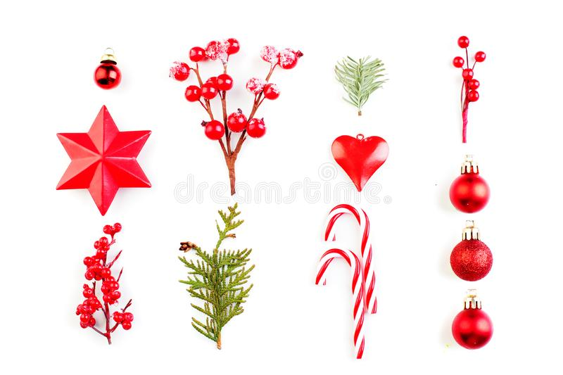 Christmas composition with Xmas candy, holly berries, star and green fir branch on white background stock photography