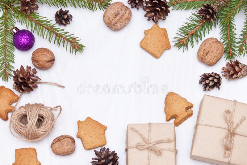 Christmas composition. Xmas gingerbread cookies, cookies in shape of houses,  fir branches, gifts on white background. New year royalty free stock photos