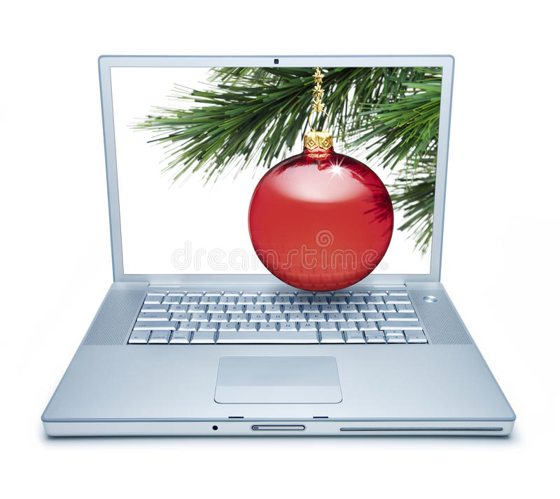 Christmas Computer Online Shopping. A laptop computer with a Christmas ornament on a tree coming out of the screen isolated on white