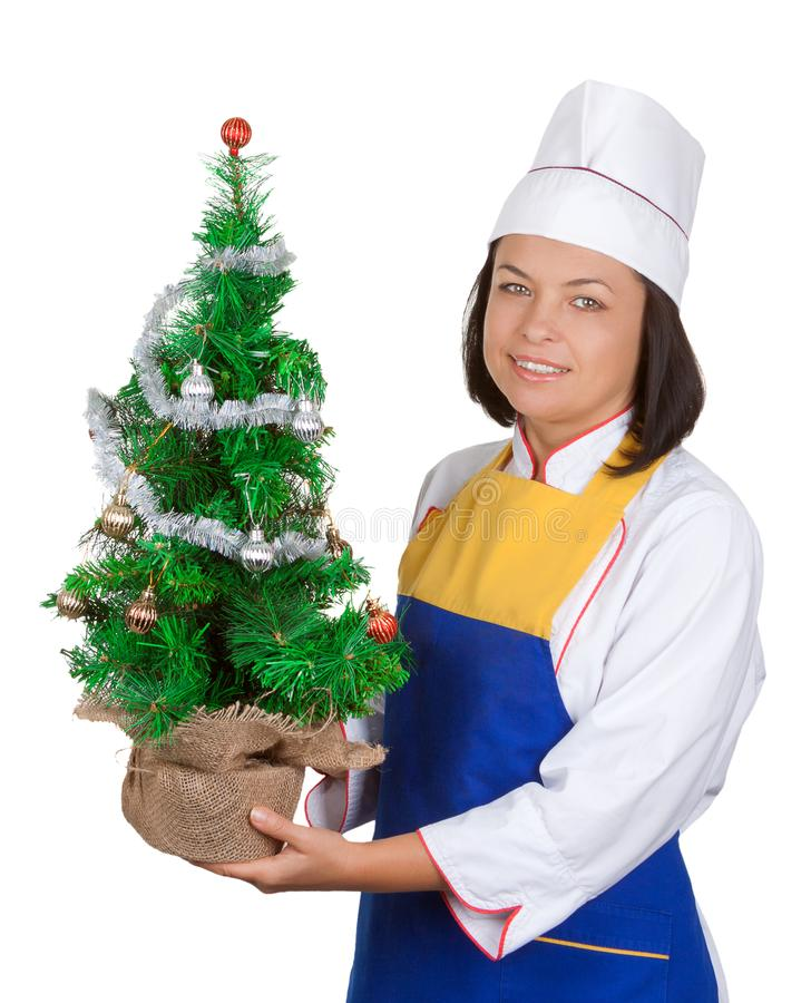 Christmas Concept. Beautiful Young Woman Chef with Decorated Christmas Tree stock images