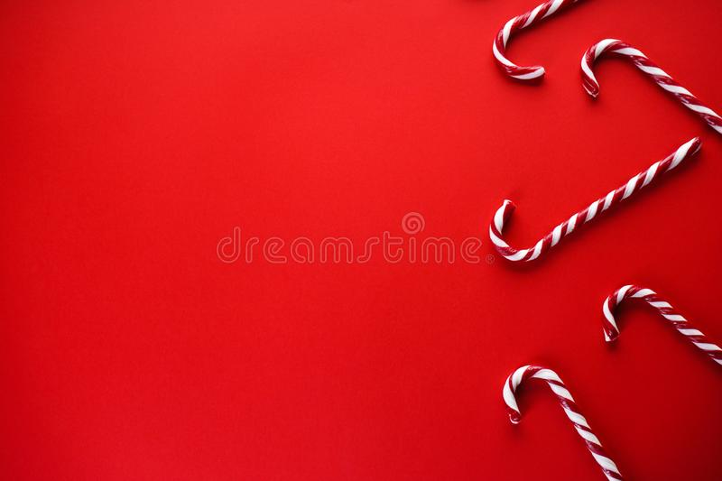 Christmas concept. Christmas candy on a red background. Traditional christmas sweets. Flat lay, place for text royalty free stock photos