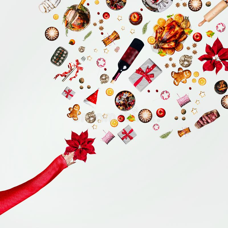 Christmas concept. Creative layout with various flying Christmas objects: table setting, holiday decoration and gift boxes and stock photography