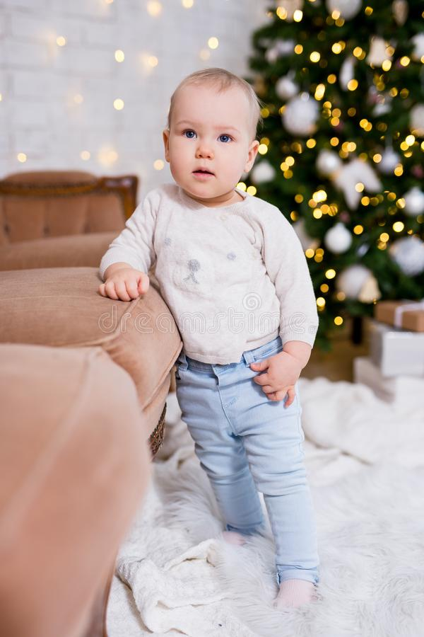 Christmas concept - cute little girl posing near decorated christmas tree royalty free stock images