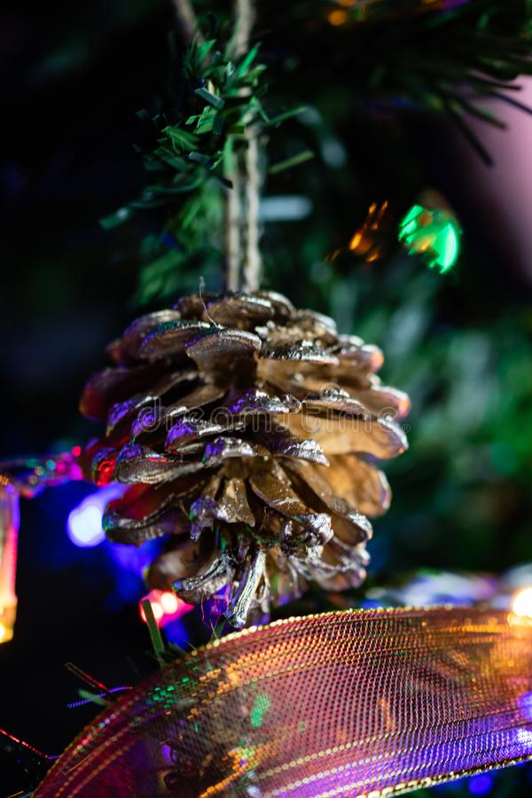 Christmas concept. Decorated Christmas tree,  Fir braches  with hanging decorations and garlands.  stock photos