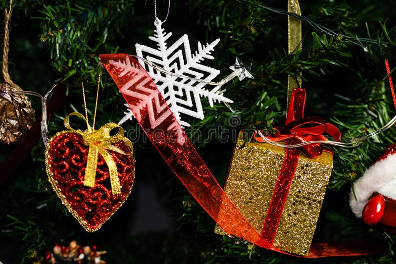 Christmas concept. Decorated Christmas tree,  Fir braches  with hanging decorations and garlands.  royalty free stock photos
