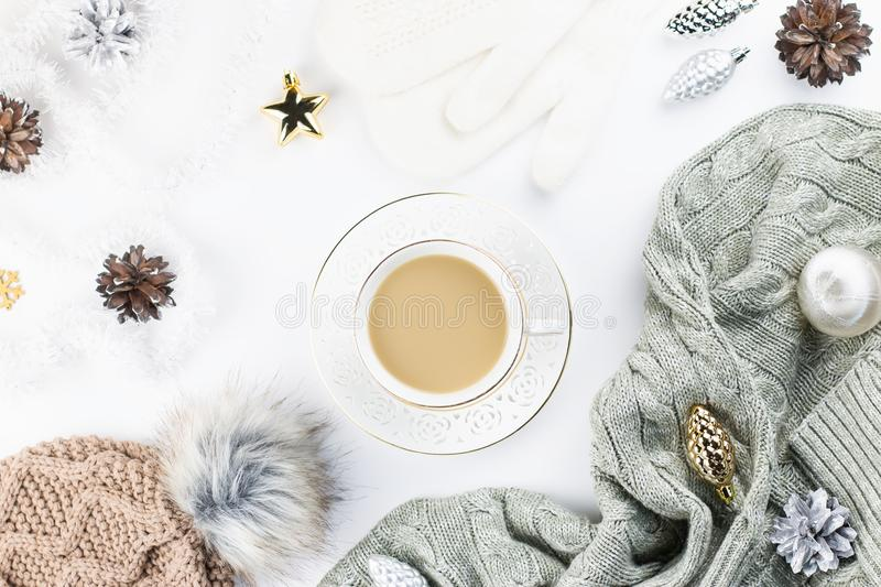 Christmas concept flat lay. Warm, cozy winter clothing and Christmas decorations frame on white background stock photo