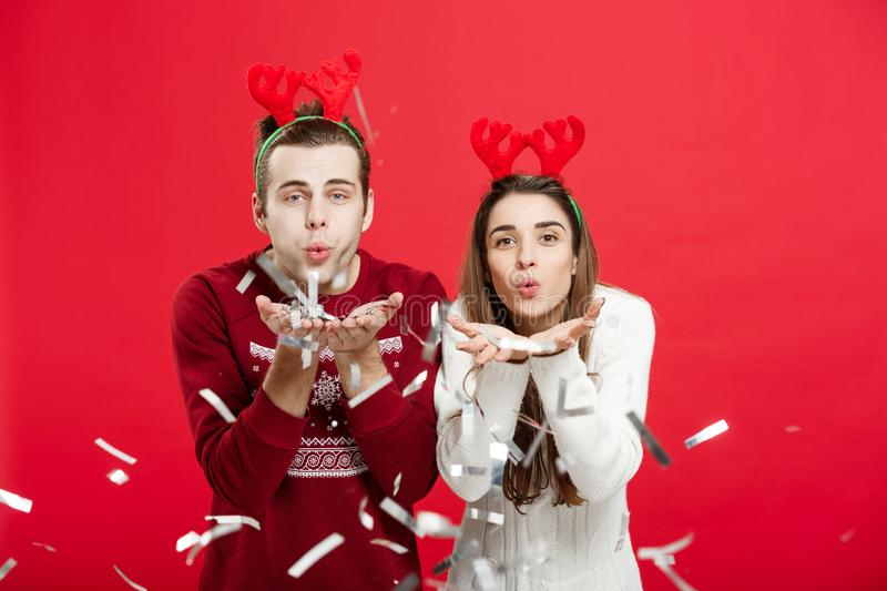 Christmas Concept - Happy caucasian man and woman in reindeer hats celebrating christmas toasting with champagne flutes. Christmas Concept - Happy caucasian men royalty free stock images