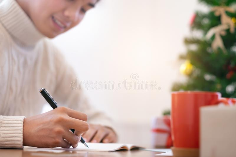 Christmas concept. Man opening christmas card. Christmas concept. Man wearing white sweater writing greeting cards royalty free stock image