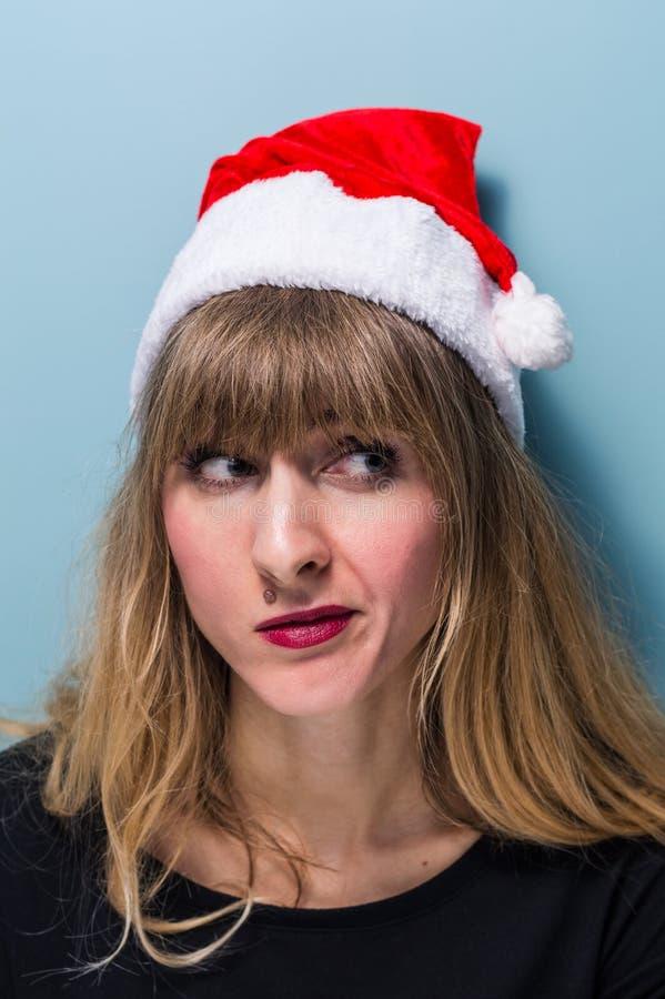 Portrait of a Beautiful blonde girl wearing santa hat stock photos