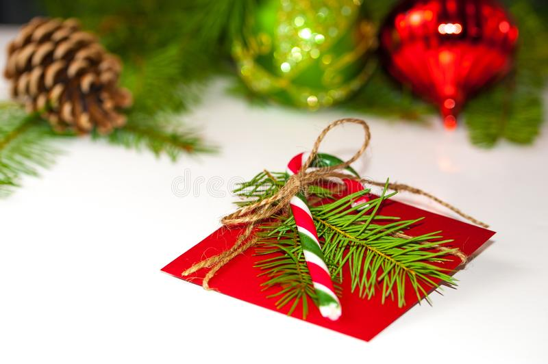 Christmas concept: red envelope decorated with a pine branch and royalty free stock photography