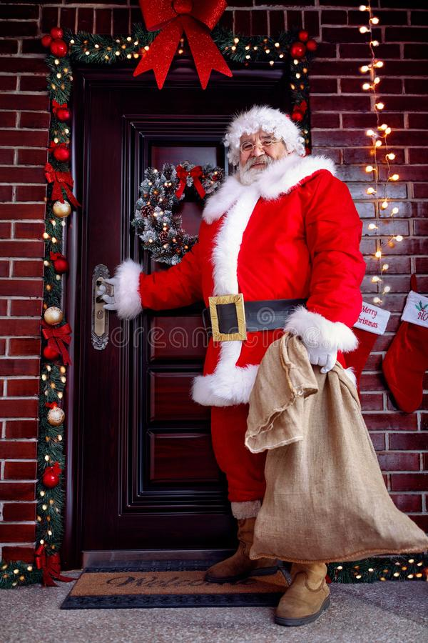 Christmas concept -Santa Claus with Christmas gift royalty free stock image