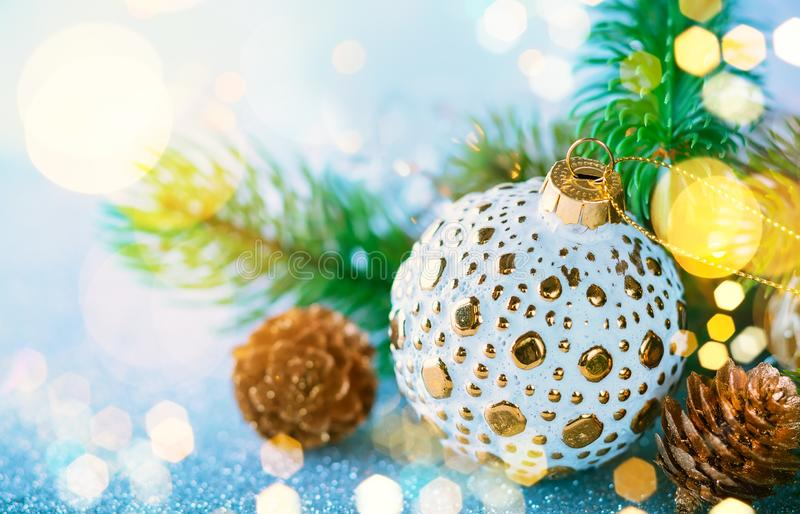 Christmas Decoration. Christmas concept with silver bauble, fir cones and festive fir tree royalty free stock photo