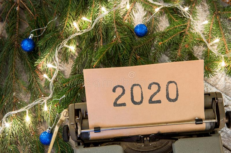 """Christmas concept - typewriter with text """"2020"""", spruce branches and garland stock images"""