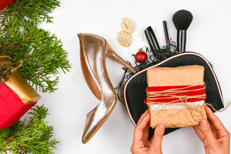 Christmas concept for women`s gifts. Flat lay of female accessories on a white background. Sales, shopping, gift ideas concepts royalty free stock photo