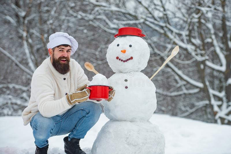 Christmas cookery. Snowman and funny bearded chefs friends. Merry Christmas and happy holidays. Christmas menu for stock photo