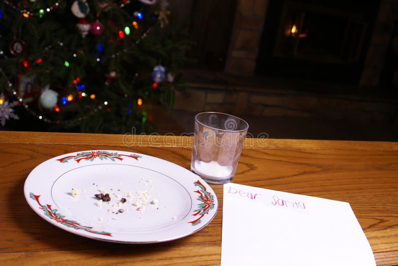 Christmas Cookie Crumbs Note From Santa Tree Fire stock image