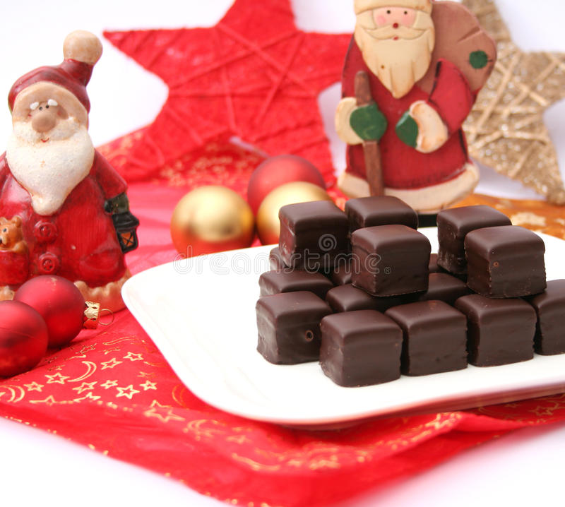 Christmas cookies. Some christmas cookies with chocolate on a plate royalty free stock images
