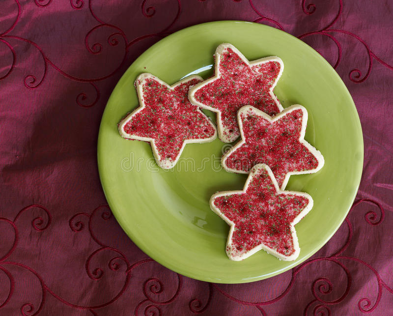 Christmas Cookies. Star Shaped Christmas Cookies on Green Plate stock images