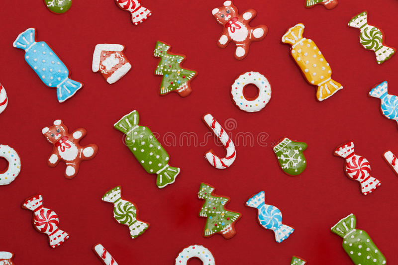 Christmas cookies background. Christmas background. Homemade delicious Christmas gingerbread cookies on a red background stock photo