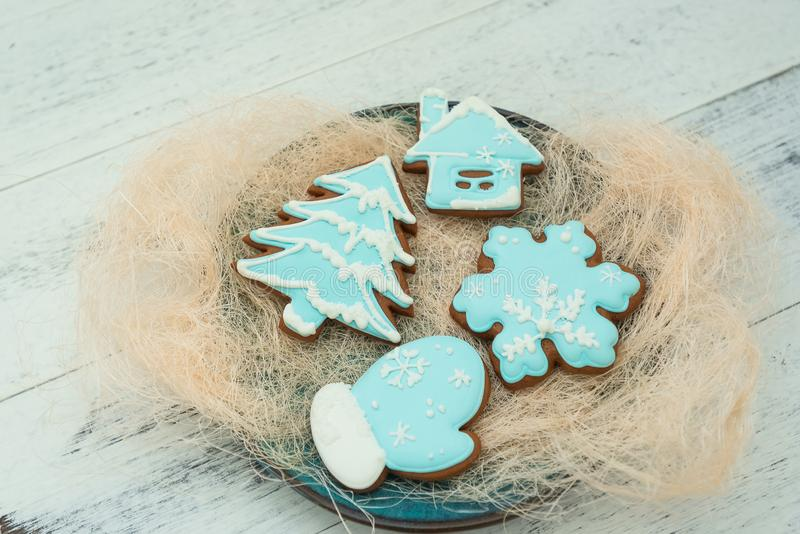 Christmas cookies with blue icing, selective focus. Winter sweets theme royalty free stock photos