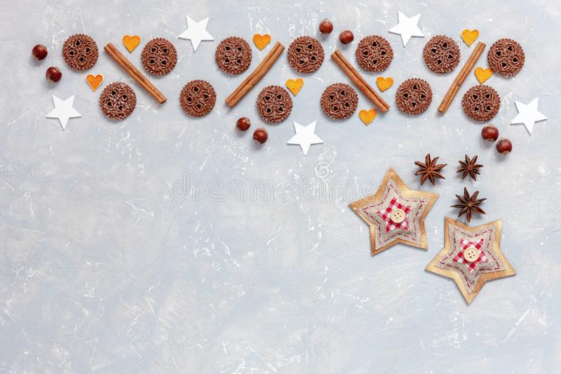 Christmas cookies with cinnamon barks and anise stars on concrete background stock photos