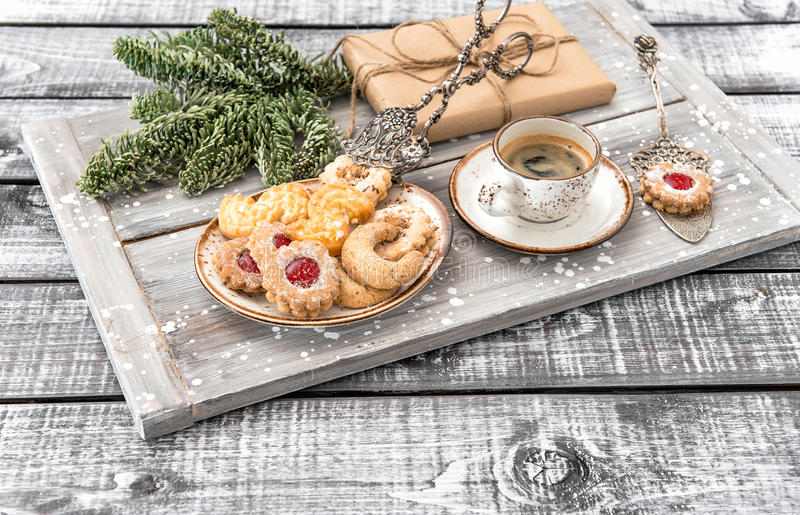 Christmas cookies coffee and decorations wooden background royalty free stock image