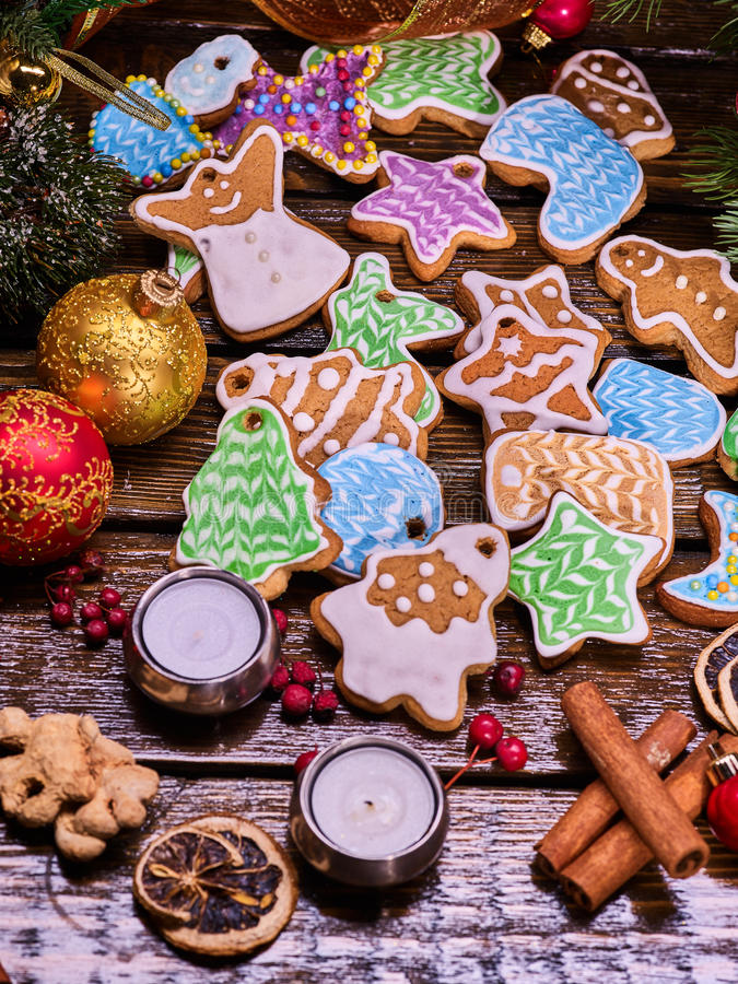 Christmas cookies and ginger root on wooden table. Christmas gingerbread cookies as decoration on woden table and candels. Christmas ball and ginger root royalty free stock photography